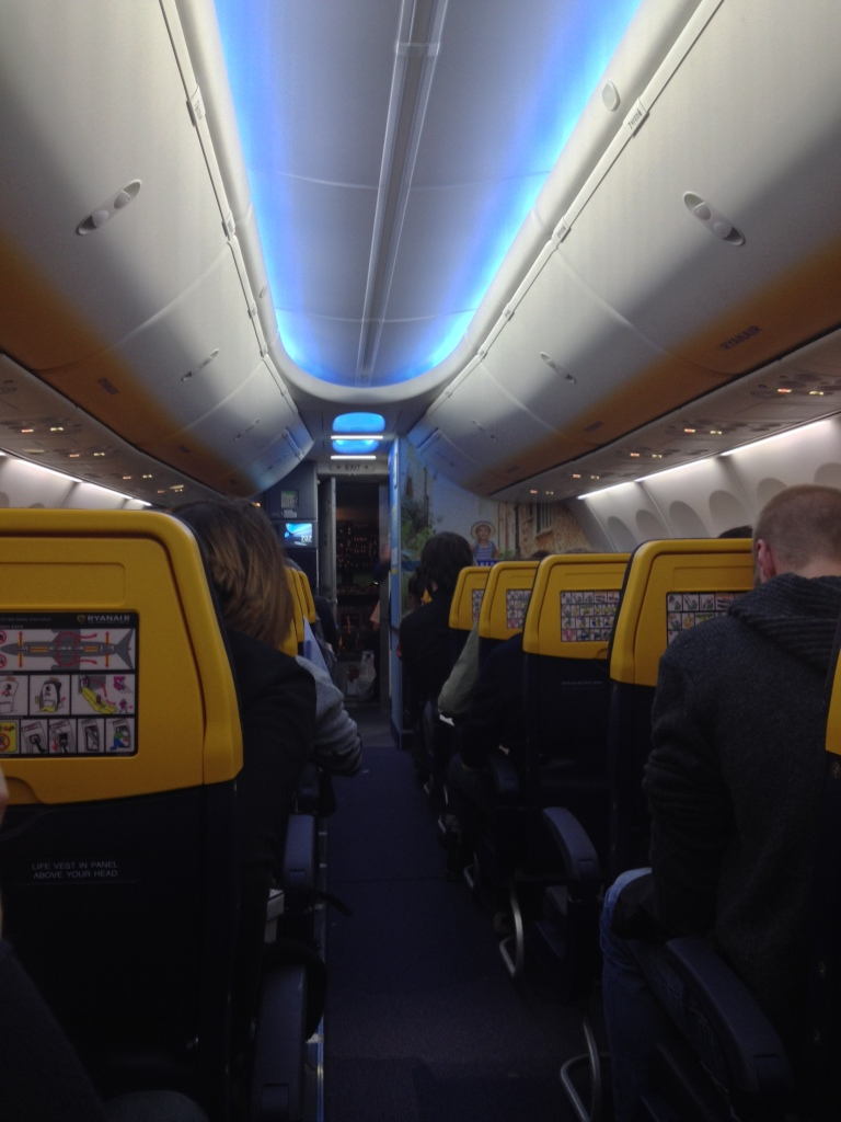 Ryanair's brand new interieur featuring blue LEDs, slimline seats and no more yellow, almost.
